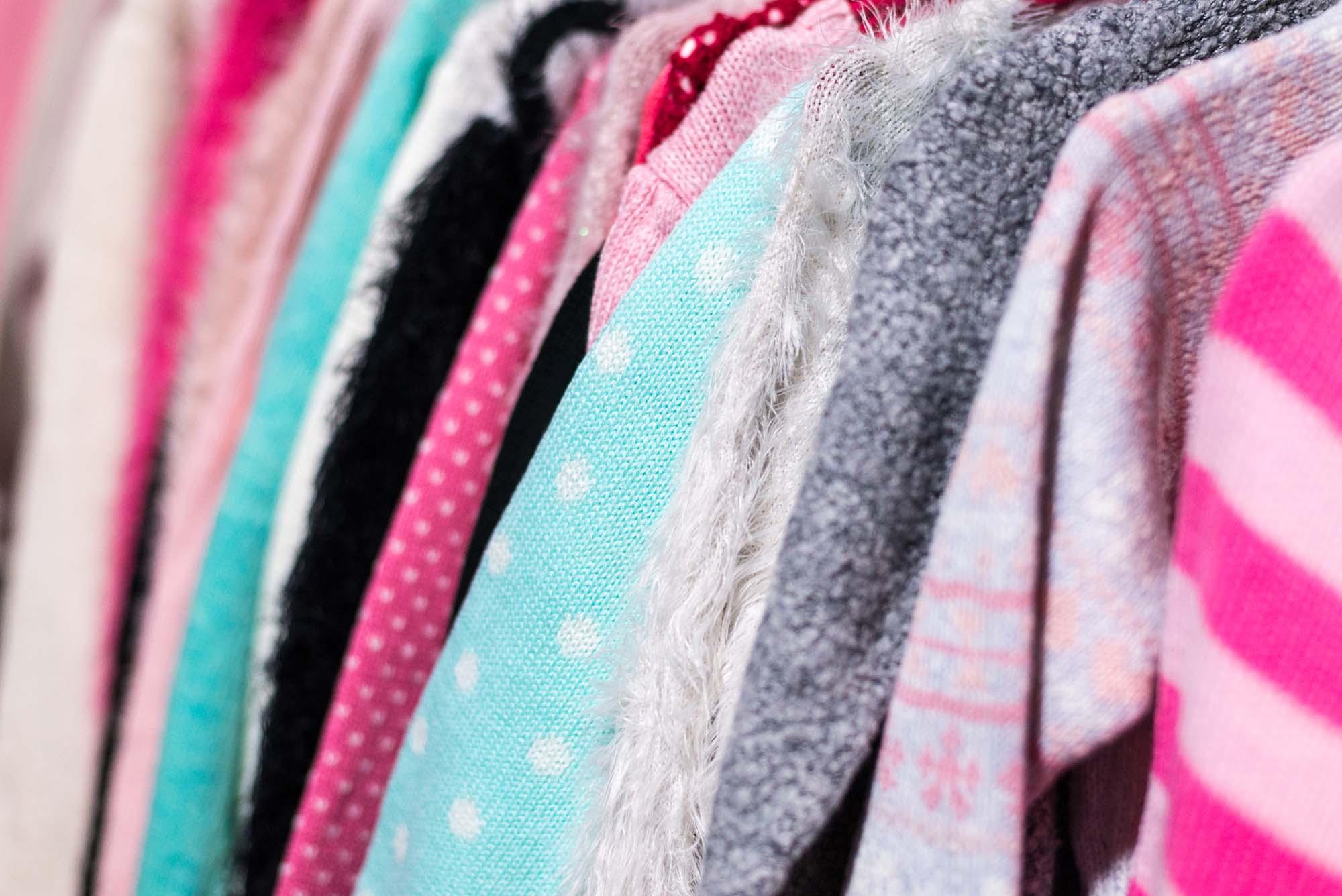 Multicoloured tops on hangers