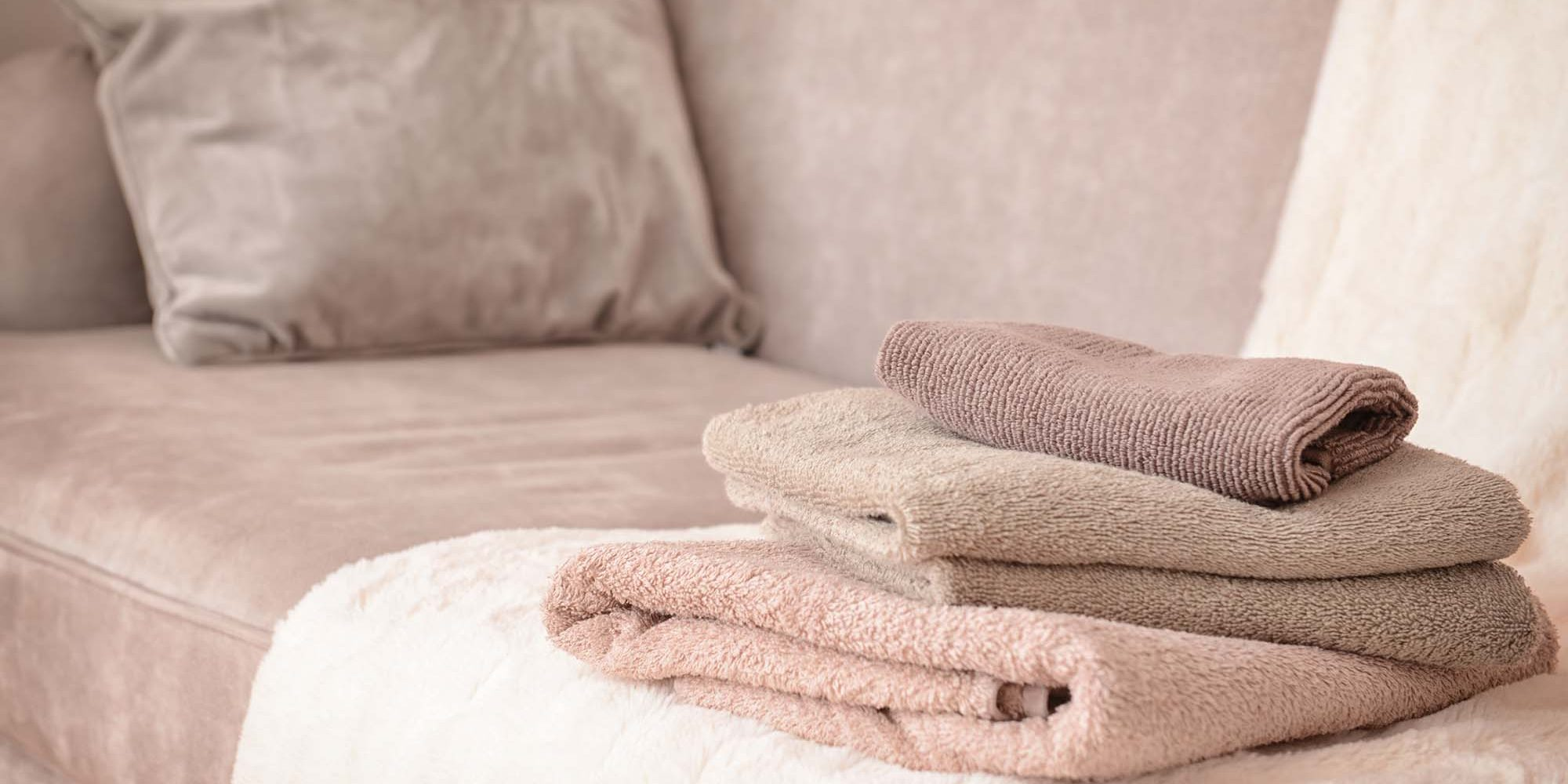 Clean soft towels on sofa
